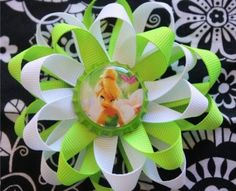 Tinker Bell loop inspired Bottle Cap Hair Bow and Headband! A white and lime green combo. This two layer bow will look adorable on your princess. Both layers are 3/8 grosgrain ribbon topped off with a Tinker Bell bottle cap. The bow measures about 4 wide.The bow is attached to a alligator clip so it can grow with your infant and even be used as just a clip in her hair. But I do attach this clip to a 1.5 white crochet headband.All bows are hand crafted and heat sealed to prevent fraying.All…