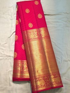 The old and the new Kanchivaram styles- traditional broad borders, gold zari work and striking red with a contemporary self-design and small butas Indian Bridal Sarees, South Indian Sarees, Indian Silk Sarees, Pure Silk Sarees, Ethnic Sarees, Indian Look, Indian Ethnic Wear, Indian Dresses, Indian Outfits