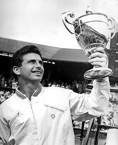 Ashley John Cooper AO (born 1936 in Melbourne) is a former world champion tennis player from Australia. He was the World No. 1 amateur player in 1957 & 1958. Cooper played his best year in 1958, becoming one of only eleven men (as of 2013) to win three of the four Grand Slam events in the same year. He won singles at the Australian, British, & American championships & was a semi-finalist at the French championship, losing to Luis Ayala 11–9, 6–4, 4–6, 2–6, 5–7. Ashley Cooper, John Cooper, Tennis Tournaments, Tennis Players, Australian Tennis, Tennis Legends, Lawn Tennis, Sport Hall, Wimbledon