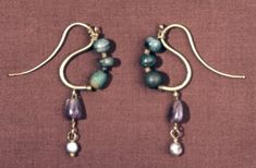 Earring 3-4 AD; one of a pair; jadeite, amethyst with pearl at bottom.