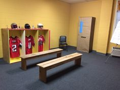 Go Fish's Victory VBS - Locker Room. Covered a bookshelf with craft paper made to look like entrance into the Coach's office.