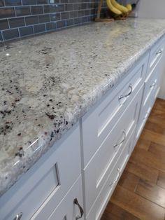 Bianco Romano granite countertops and SOLLiD® Cabinetry | Accent Interiors | SLC, UT