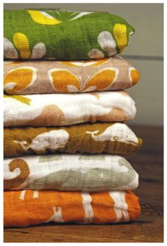Gorgeous earthy colours and designs make these burp cloths by Zebi the perfect unisex baby shower gift - available now at http://www.studio-dragonfly.net