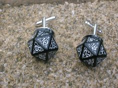 alternative wedding, black d20 dice with elven design numbers and patterns.