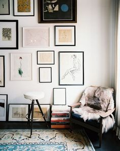 Gallery wall display; love the varying sizes and frames