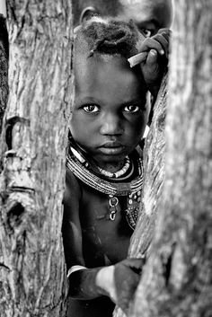 A shy, young Himba girl in the Epupa region of Namibia ©Matthieu Rivart