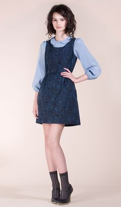 Nadinoo's navy blue pinafore with seasonal print over a light blue blouse plus socks and heels