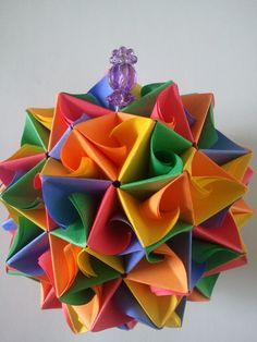 """3d Origami kusudama ANT-LION $25.00 Kusudama Ant-lion was made from 90 multicolored paper rectangles without glue. The kusudama is 4""""D."""