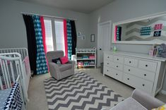 Neutral gray and white chevron with bright pops of color for boy/girl twins' nursery!
