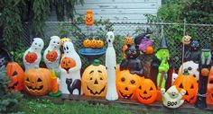 Halloween themed blow molds laughing at on-lookers!