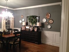 Sherwin Williams Software (paint)  Antique buffet and antique silver mixed with modern lamps and mirror.