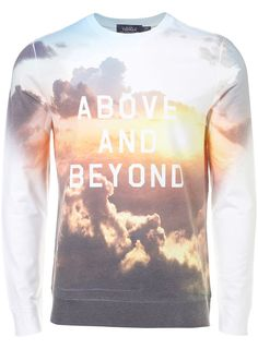 This jumper has a picture of the sky while the sun was setting with nice wording over the image.