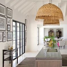Crisp black and white; striped rug kept from looking too clinical /harsh by oversized wicker pendant lights.