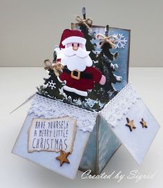 Handmade card in a box by DT member Sigrid with Collectables Eline's Santa (COL1391), Craftables Punch Die Snowflakes ( CR1335), Creatables Pine Tree (LR0136) and Grass (LR0360) by Marianne Design