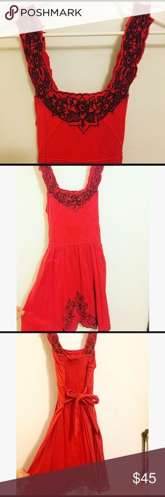 """Free People red Spanish sundress 2 s Great dress by Free People. Flattering fit with cotton material that has some give so that it hugs basically anyone in just the right way. Hidden side zipper closure and dash in back to tailor fit even more for your particular body. Small rip in seam that I hadn't even noticed until close inspection, very easy to fix with needed and thread.   I am 5'6"""" with a booty and this falls above my knees but long enough to meet my bf's parents💕👗Please see my…"""