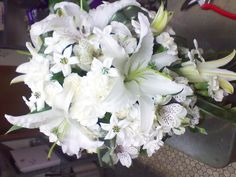 white bouquet rose and stephanotis | White lily and stephanotis bouquet
