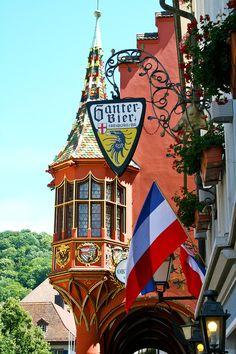 A charming shop sign and a magnificent oriel window Freiburg im Breisgau Baden-Württemberg Germany