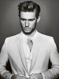 Jamie Dornan - Again, simple profile. Key light flying high, straight over. BW. Suit - tie. Buttons undone. Preoccupied hands