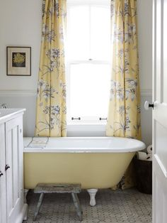 Modern Country A soft color scheme of yellow, white and graphite makes the main bathroom in Sarah Richardson's farmhouse feel like a country afternoon: bright and fresh. A vintage bathtub and other timeworn treasures fit the old-fashioned home.