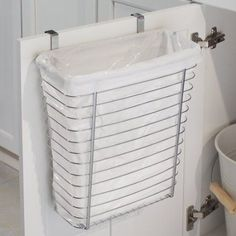 Get an over-the-cabinet-door wastebasket. | 44 Cheap And Easy Ways To Organize Your RV/Camper