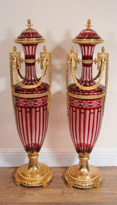 Pair of French Empire cut glass and ormolu urns in the classic amphora shape