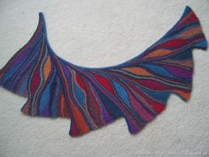 Wingspan - http://www.ravelry.com/patterns/library/wingspan-2 - Swing Knitting technique.  Love this!!