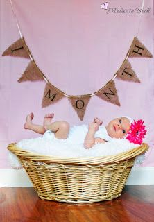 Monthly baby pictures - 1 month. I would write it on the chalkboard wall behind the basket.