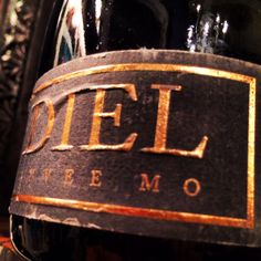 """lst nt by myself at pitch-dark #momofuku ssam bar stalking pork buns and a cheap, interesting bottle of #wine. Tried 'Schlossgut Diel Cuvee MO '95' liking its cuvee initials and thinking it a fair $45.   Bill came, it was actually $145! Holy ice buckets!--my bad. Saving grace: it was gorgeously complex, exciting Pinot Noir/Gris bubbly fr Germany.  The best German 'sekt' (sparkling wine) I've had.  Worth the extra """"1""""...I guess."""