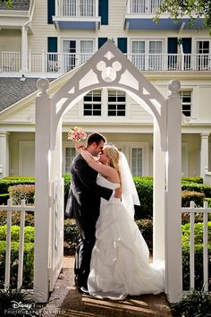 Bride + groom archway shot, complete with a Hidden Mickey at Disney's BoardWalk Resort
