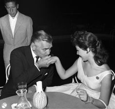 Clark Gable charming a lady in Rome, 1959.