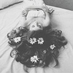 Flowers and long, wavy hair