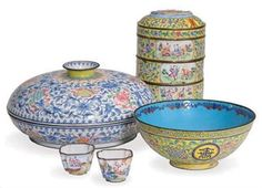 """A CHINESE """"CANTON ENAMEL"""" THREE-TIERED BOX, A CIRCULAR SWEETMEAT DISH AND COVER, AND A BOWL,"""