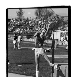 Black and white photo of an unidentified University of Oregon high jumper beginning a jump at Hayward Field in 1981. ©University of Oregon Libraries - Special Collections and University Archives