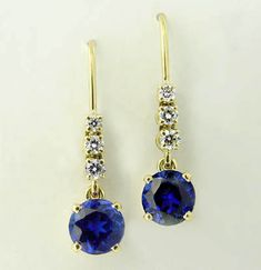 Refined and Gorgeous. Designed to hang off the ear; fine Diamonds falling into the deep blue of the Tanzanite. Movement is imparted to the Tanzanites by way of an extra loop between the posts and the stones, ensuring that the earrings move naturally on the ear.