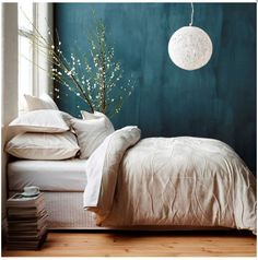 Color TEAL in bedroom. Perfect with grey, silver and white.
