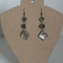 Fun and simple these earrings are sure to dress up any outfit.  They total 3 in. long and are on black hooks.