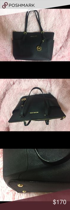 Michael Kors Black and Gold Purse Black with gold accents, it has a couple white marks which I have taken two pictures of. One on the bottom(hardly visible unless turned upside down) and the other two small white spots on the back of the purse. Other than those marks the purse is in great condition. Clean. Can take pictures of the inside if anyone wants! Authentic, purchased from Michael Kors store. No tags or receipt available. KORS Michael Kors Bags Totes