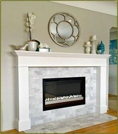 black box fireplace with river rocks instead of glass but shows the contrast with white surround and marble tiles.