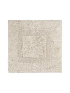 Paksussa ja pehmeässä kylpyhuoneen matossa on hillityn tyylikäs kuviointi…