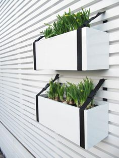 "plant box and belt .these ""belts"" look more like strap webbing and could be DIY made to size. If you wanted to non-installed plant box and had a railing, this could work, like a porch / deck rail Outdoor Spaces, Outdoor Living, Plant Box, Planter Boxes, Hanging Planters, Deck Railing Planters, Porch Railings, Hanging Gardens, White Planters"