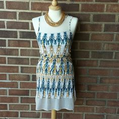 Blue and Yellow Tribal Print Dress Sleeveless. Sheer panels in the front, back and at the hem. Great condition. Necklace not included. Shrug sold separately. H&M Dresses