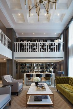 Great ceiling; interesting treatment of moulding inside the coffered areas... gives it a transitional or more contemporary twist.  Lighting; would have used a different railing / stairway style for this application