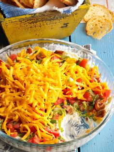 Whip up this addictive layered three-cheese dip. | Layered BLT Dip Recipe from Taste of Home