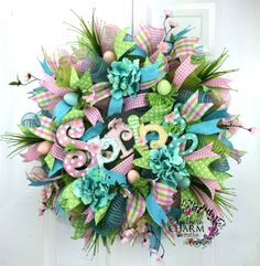 Deco Mesh Spring Wreath with Spring Sign and Blue Hydrangeas by www.SouthernCharmWreaths.com #spring #decor #diy