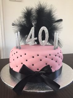 Glamour filled cake for 40th birthday in pink with black diamanté and ostrich feathers