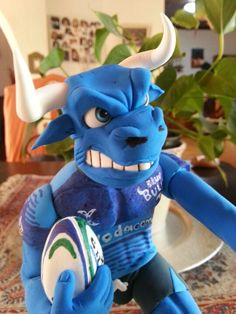Blue bull close up Rugby, Party Planning, Smurfs, Action Figures, Hero, Gifts, Blue, Handmade, Birthday Cakes