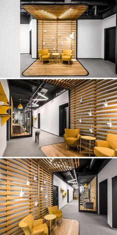 Just outside the reception area in this modern office is a hallway that has a clearly defined seating areas. Wood slats with a black frame wrap around from the ceiling to the wood floor.