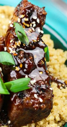 Slap Yo Mamma Spicy Sticky Asian Ribs ~ Spicy sticky asian ribs are drizzled in a sweet and spicy glaze, kissed to a slight crunch on the grill, and melt-in-your-mouth, incredibly tender on the inside.. These pork ribs are finger-lickin' and slap yo mama silly kind of 'good'.