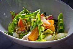 Dungeness crab with snap peas, apricots and spring onion at Local's Corner, where the menu depends on the daily catch and harvest. Not having a full kitchen, chefs prepare food in unconventional ways - if the dishes require cooking at all. Photo: John Storey, Special To The Chronicle