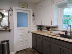 Repaint Your Kitchen Cabinets with This Stylish Combo Love the gray lowers and white uppers, with white washed butcher block counter,